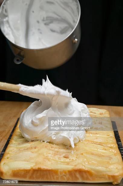 spreading apple cake with meringue - 卵白 ストックフォトと画像