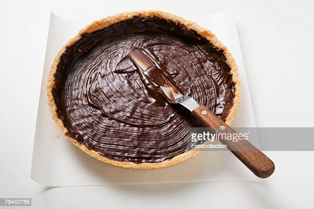 Spreading pastry case with chocolate