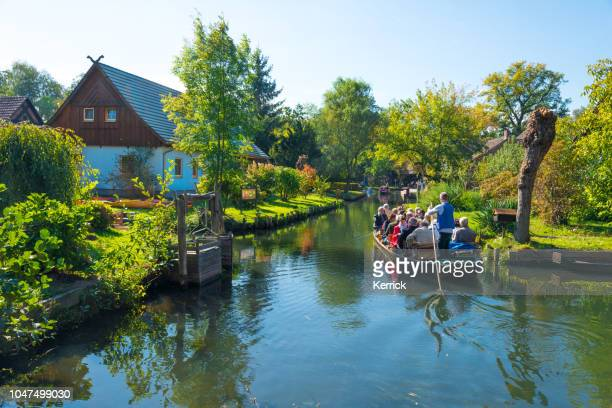 spreewald lübbenau, lehde - tourist in boat under bridge in forest rivers - spreewald stock pictures, royalty-free photos & images