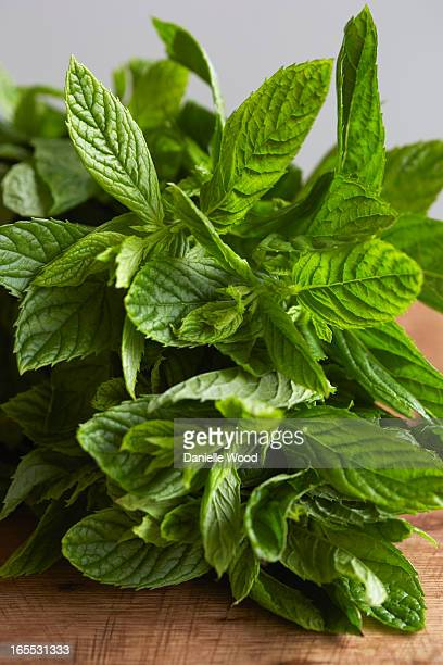 Sprig of mint on wooden board