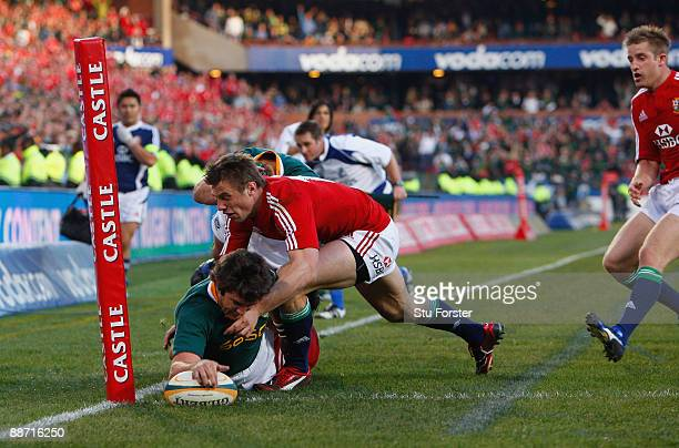 Sprinboks replacement Jaque Fourie dives over to score a try during the Second Test match between the South Africa and the British and Irish Lions at...