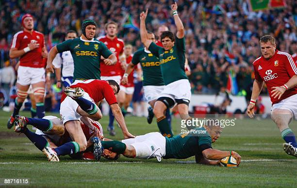 Sprinboks winger Bryan Habana dives over the line to score a try during the Second Test match between South Africa and the British and Irish Lions at...