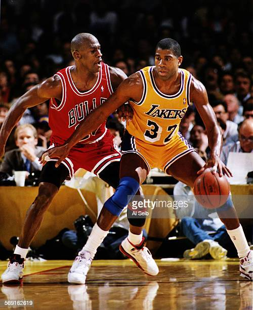 Spring 1991 –– Los Angeles Lakers Magic Johnson right is guarded by Michael Jordan of the Chicago Bulls in the 1991 NBA Finals in Los Angeles