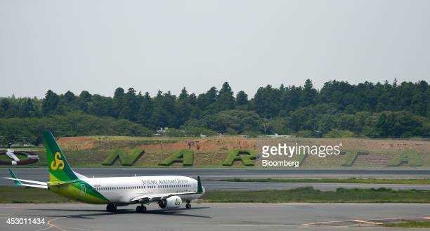 A Spring Airlines Japan Co aircraft taxis at Narita Airport in Narita Chiba Prefecture Japan on Friday Aug 1 2014 Spring Airlines Co Chinas biggest...