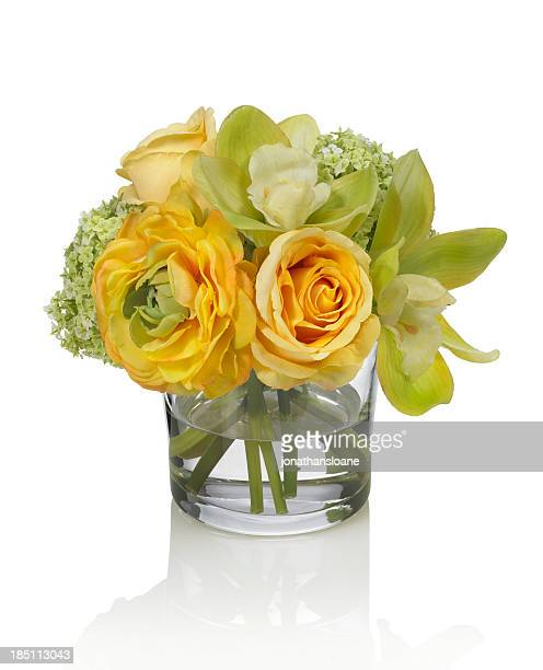 Spring bouquet with orchids and ranunculus on white background