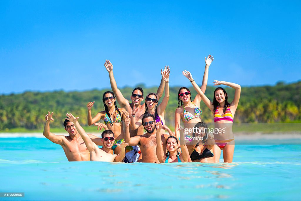 Spring break group of young people having fun tropical beach : Stock Photo