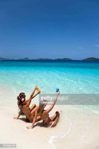 spring break women toasting on a beach