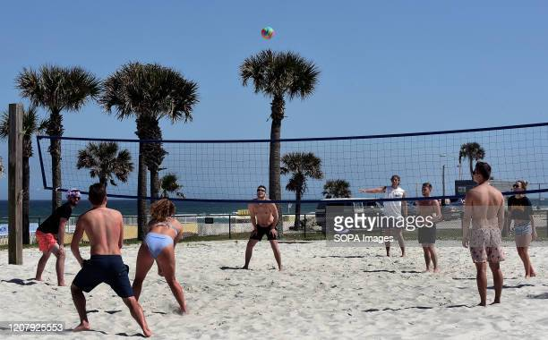 Spring breakers play volleyball during a spring break at Daytona Beach after Florida Governor Ron DeSantis refused to order the state's beaches...