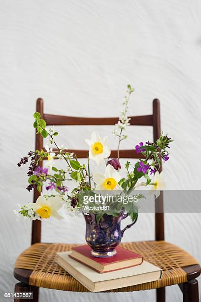 Spring bunch of flowers on chair