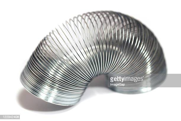 spring coil toy - metal coil toy stock photos and pictures