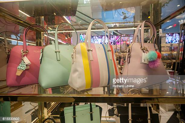 Spring colored handbags on display at the Kate Spade boutique within Macy's in New York on Sunday March 20 2016