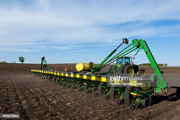 spring corn planting - agricultural machinery stock pictures, royalty-free photos & images