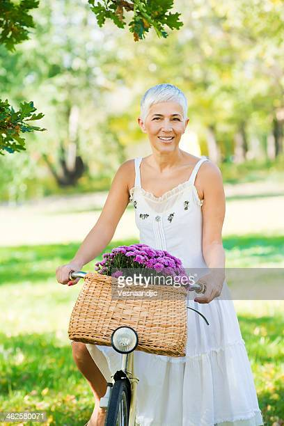 spring cycling - yellow dress stock pictures, royalty-free photos & images