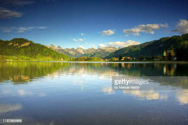 spring feeling at the lake sihlsee - wolke stock pictures, royalty-free photos & images