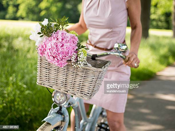 Spring flowers in the basket of a classic bicycle