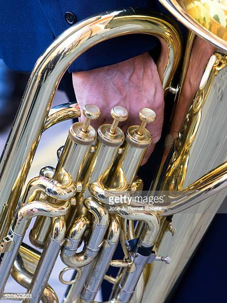 I spring from a musician taking hold a trombonist