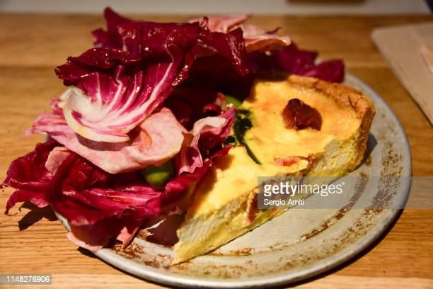 Spring herbs quiche with radicchio salad