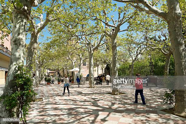 spring light in spanish village square - hugh threlfall stock pictures, royalty-free photos & images
