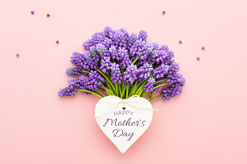 Spring lilac flowers and a heart shape card Happy Mother's Day on pink. 1145047770
