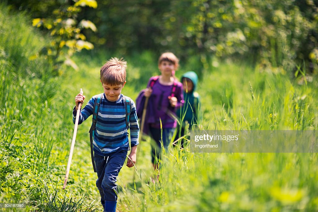 Spring little hikers walking among fresh green  nature : Stock Photo