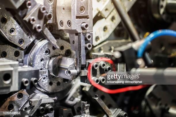 spring machine,close-up of coiled metal springs - kunsthandwerkliches erzeugnis stock-fotos und bilder