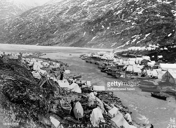 Spring of 1898 gold seekers who crossed the Chilkoot and White Passes heading toward Dawson City pitched their tents along the shores of Lake Benett...