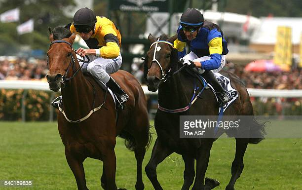 Spring Racing Carnival 2006 Jockey Steven Arnold rides Maybe Better yellow and black colours to victory in Race 2 on Derby Day at Flemington...