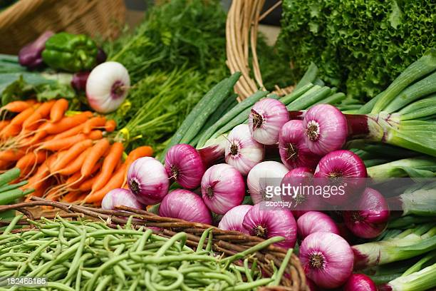 spring red onions at a farmers market.