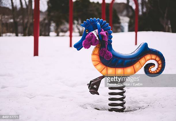 Spring Ride In Snow Covered Playground