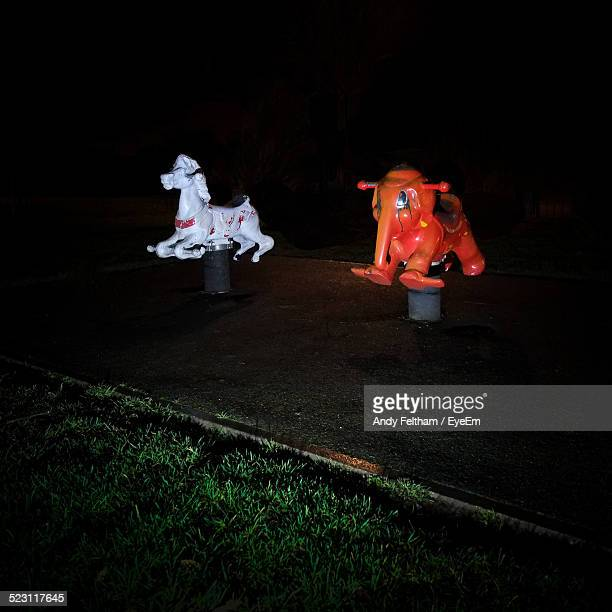 spring rides at night - animal representation stock pictures, royalty-free photos & images