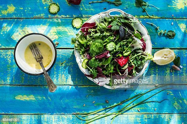Spring salad of baby spinach, herbs, arugula and lettuce, dressing of yogurt, olive oil, honey and lemon
