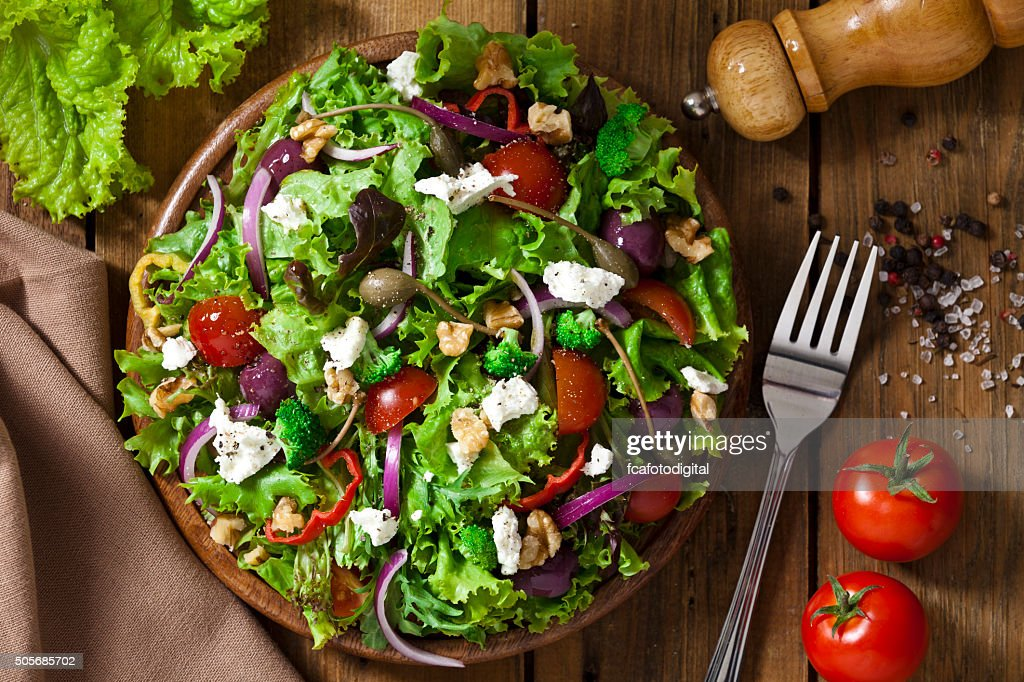 Spring salad shot from above on rustic wood table : Stock Photo