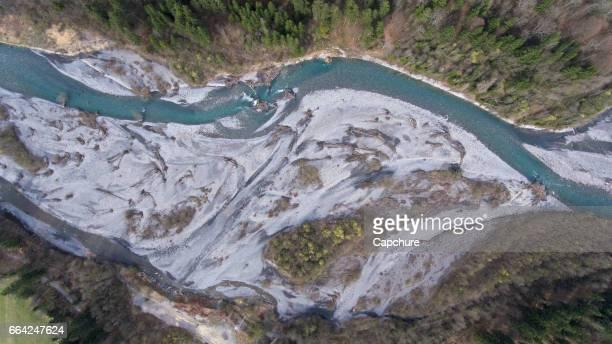 spring snow melt river in the french alps and mountains - flussbett stock-fotos und bilder