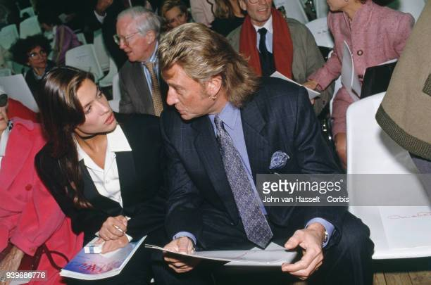 Spring Summer Prêt à porter catwalk show French singer and actor Johnny Hallyday with his fiancee Karine Martin 16th October 1992