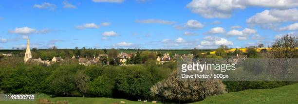 spring, the village green at barrowden village, rutland county - elm tree stock pictures, royalty-free photos & images