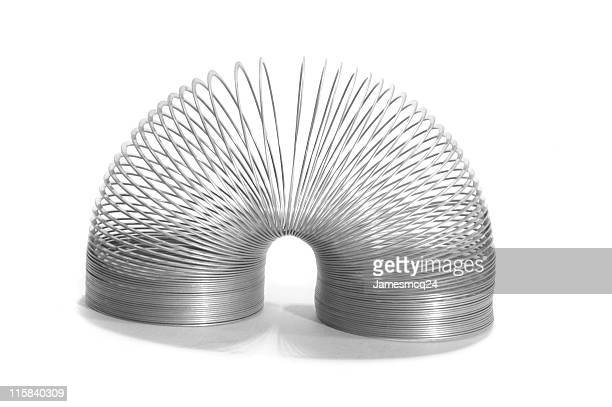spring toy - metal coil toy stock photos and pictures