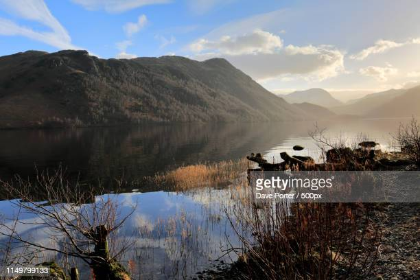 spring view of ullswater from glenridding, lake district nationa - snowcapped mountain stock pictures, royalty-free photos & images