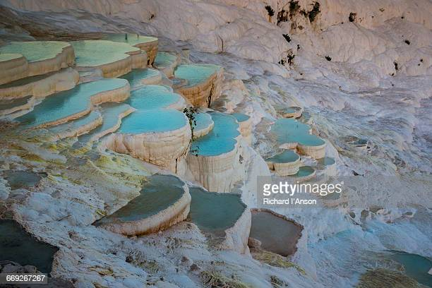 Spring water in stepped travertine terraces