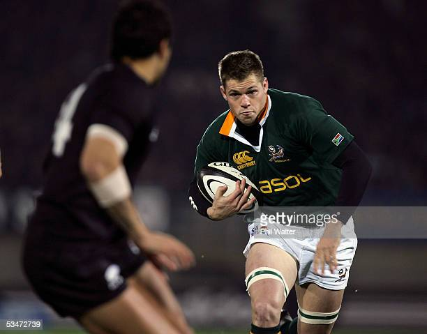 Springbok Joe Van Niekerk has his path blocked by All Black Rico Gear in the Tri Nations match between the New Zealand All Blacks and the South...