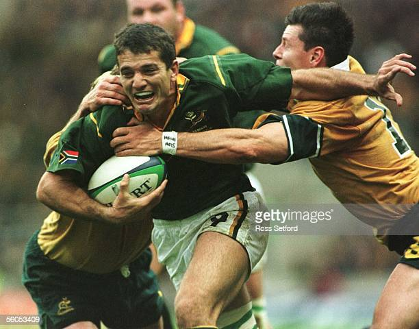 Springbok Joost van der Westhuizen fends off Wallaby Jason Little in the semi final of the Rugby World Cup at Twickenham London Saturday Australia...
