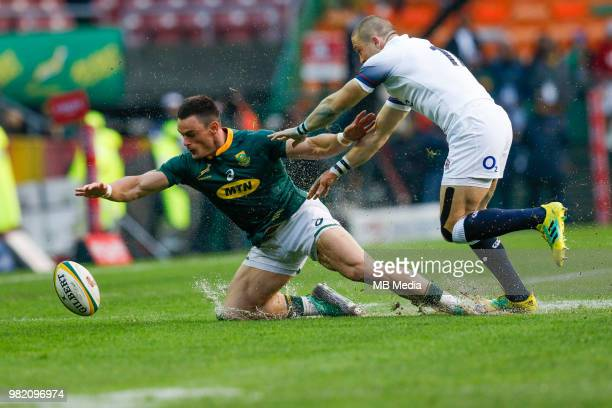 Springbok player Jesse Kriel dives for the ball while England player Mike Brown watches on at Newlands Stadium on June 23 2018 in Cape Town South...