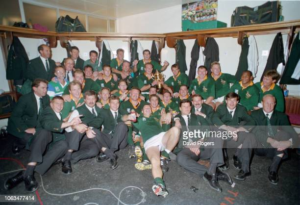 Springboks captain Francois Pienaar holds the trophy as his team mates celebrate in the dressing room after their 1995 Rugby World Cup Final victory...