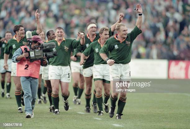 Springboks captain Francois Pienaar leads his team including Joost van der Westhuizen on a lap of celebration after their 1995 Rugby World Cup Final...