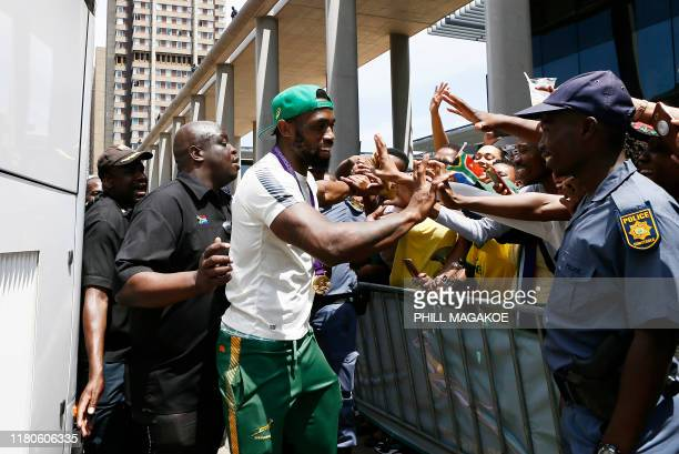 Springboks captain Siya Kolisi greets supporters during a parade through the central business district of Pretoria on November 7 2019 The Springboks...