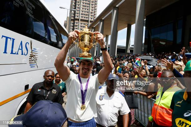 Springboks lock Eben Etzebeth hold the Web Ellis trophy while parading through the central business district of Pretoria on November 7 2019 The...