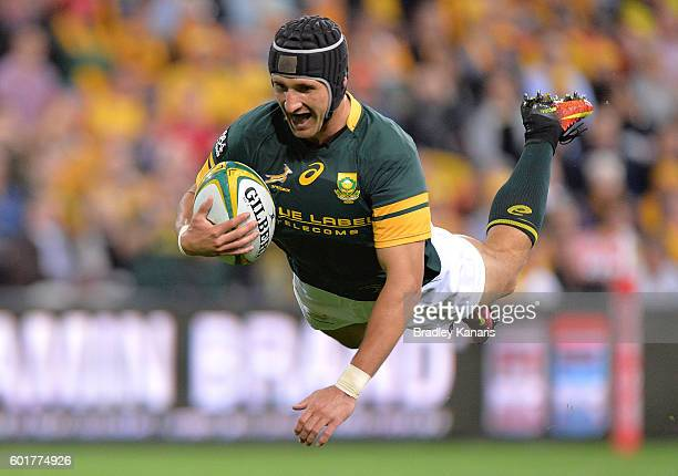 Springboks player Johan Goosen dives over to score a try during the Rugby Championship match between the Australian Wallabies and the South Africa...