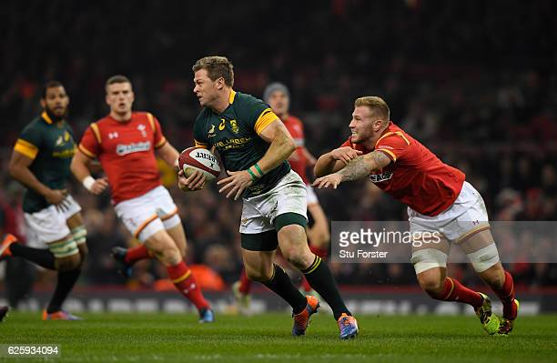 Springboks player Ruan Combrinck escapes the clutches of Ross Moriarty of Wales during the International match between Wales and South Africa at...