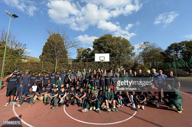 Springboks pose with the kids during the Springbok Rugby Team Project Visit at Wanderers Club, Illovo on August 06, 2013 in Johannesburg, South...