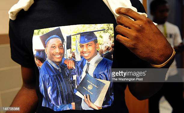 Springbrook High School alumni Edward Herbert shows off a tshirt he had made with a picture of himself left and Damon Brooks right after last year's...
