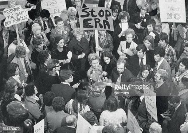 Surrounded by supporters and reporters STOP ERA leader Phyllis Schlafly of Alton Ill State Sen James Donnewald for his help in fighting ERA passage...